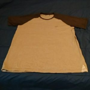 Adidas mens shirt pretty sure it's an X large.